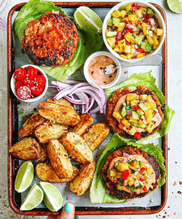 MEXICAN SALMON BURGERS, CHILI LIME FRIES and PINEAPPLE JALAPEÑO CUCUMBER SALSA by @starinfinitefood • • • Deets: BURGERS: 1/2 pound cooked salmon (skin removed), 1/3 cup ground tortilla chips (I used @sietefoods), 1.5 tablespoon mayo, 1 teaspoon mustard, 1/4 teaspoon salt, 1/2 teaspoon cumin, 1/4 teaspoon paprika, 1/4 teaspoon garlic powder, 2 tablespoon cilantro, 1 egg yolk, 1/3 cup minced onion. 1️⃣ Use a fork to flake the salmon in a bowl. Add all other ingredients, mix together well until everything is mixed together. Form into 3-4 patties. 2️⃣ Heat 2 teaspoon of oil over medium high and cook about 3 minutes per side. SALSA: 1 cup diced pineapple, 1 cup diced cucumber, 1/4 cup diced red onion, 1 tablespoon chopped cilantro, 1-2 teaspoon minced jalapeño, 2 tablespoon lime juice, 1/4 cup minced red bell pepper, 1/4 teaspoon Salt or to taste. AIOLI: mix together a few tablespoon Greek style yogurt, 2 teaspoon lime juice, chipotle hot sauce to taste and a few dashes of coconut aminos. (I eye balled this). FRIES: same method as four posts back, change seasoning to 1/2 teaspoon salt, 1/2 teaspoon chili powder, 1/2 teaspoon lime zest.