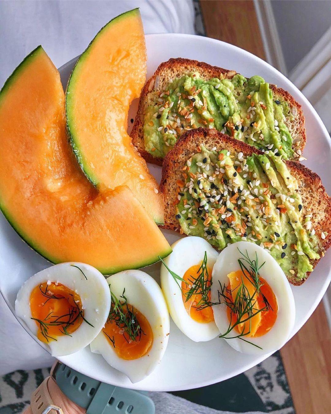 Toast w avo and everything seasoning boiled eggs and cantaloupe by @nurturingbodyandmind